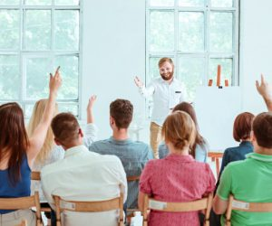 speaker-business-meeting-conference-hall_155003-2064